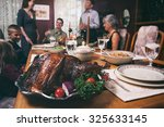thanksgiving  turkey sits on... | Shutterstock . vector #325633145
