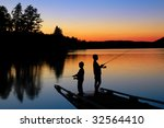 Fishing On The Dock At Sunset