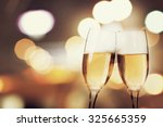 champagne glasses on sparkling...