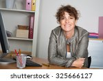 Cute businesswoman  looks at...