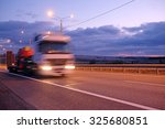 truck on a highway in the night   Shutterstock . vector #325680851