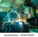 team welding robots represent... | Shutterstock . vector #325692695
