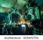 team welding robots represent... | Shutterstock . vector #325692701