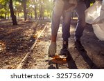 young man picking up trash... | Shutterstock . vector #325756709