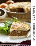 Mushroom and beef pie, with a rocket salad. - stock photo