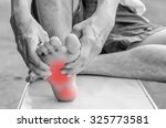 pain in the foot. massage of... | Shutterstock . vector #325773581