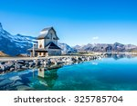 Water reflection in  mountain lake above Grindelwald, Switzerland. - stock photo
