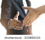 handshake | Shutterstock . vector #325800131