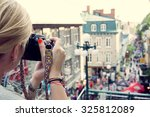 young woman taking pictures on... | Shutterstock . vector #325812089