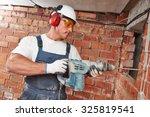 builder worker with pneumatic...   Shutterstock . vector #325819541