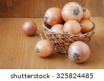 onion on a wooden background | Shutterstock . vector #325824485