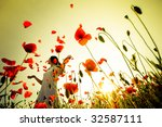 girl stands in poppy field | Shutterstock . vector #32587111