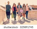 friendship and shopping concept.... | Shutterstock . vector #325891745