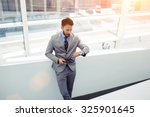 portrait of a confident... | Shutterstock . vector #325901645