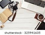 working table of photographer...   Shutterstock . vector #325941635