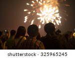 Fireworks With Silhouettes Of...
