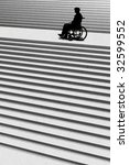 wheelchair and stairs - stock photo