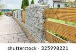 garden fence with gabions | Shutterstock . vector #325998221