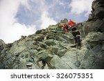 Two Mountaineers On The Ridge...