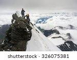 Mountaineers Climbing...