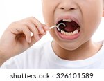 close up young asian boy using... | Shutterstock . vector #326101589