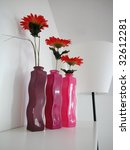 Blooms in three different colors glass vases - stock photo