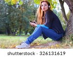 girl autumn leaves casual player | Shutterstock . vector #326131619