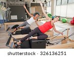 two girls are exercising... | Shutterstock . vector #326136251