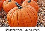 Pumpkins Lined Up For Sale At...