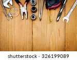 many tools on wooden background | Shutterstock . vector #326199089