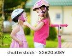 little girl helping her sister... | Shutterstock . vector #326205089