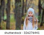 adorable little girl outdoors...   Shutterstock . vector #326276441