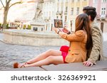 young smile  couple sitting on... | Shutterstock . vector #326369921