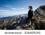 young caucasian woman hiker on... | Shutterstock . vector #326409245
