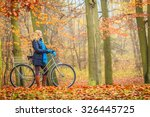 active woman riding bike... | Shutterstock . vector #326445725