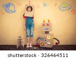Happy Kid Playing Toy Robot - Fine Art prints