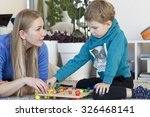 mother and son are studying | Shutterstock . vector #326468141