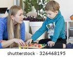 mother and son are studying | Shutterstock . vector #326468195