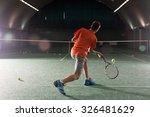 Young Tennis Player Kicking Th...