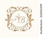 elegant floral monogram design... | Shutterstock .eps vector #326562359