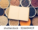 various legumes and a blank recipe book - stock photo