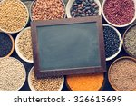 top view of various legumes and chalkboard - stock photo