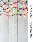 christmas lights over white... | Shutterstock . vector #326617721