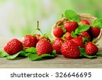 Ripe Strawberries With Leaves...