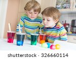 two adorable little twins boys... | Shutterstock . vector #326660114