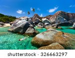 young woman snorkeling in... | Shutterstock . vector #326663297