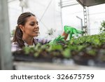 young female botanist seeding... | Shutterstock . vector #326675759