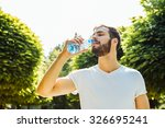 close up of a man drinking... | Shutterstock . vector #326695241