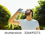 close up of a man drinking... | Shutterstock . vector #326695271