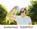 close up of a man drinking... | Shutterstock . vector #326695547
